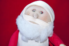 Santa claus doll on red background Royalty Free Stock Image