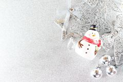 Santa Claus doll and shiny silver ornaments on bright background, Top view or flat lay with copy space Stock Image