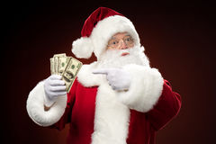 Santa Claus with dollars. On dark red background Stock Photography