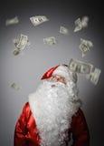 Santa Claus and dollars. Santa Claus and falling dollars banknotes. Currency and lottery concept Royalty Free Stock Photos