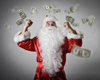 Santa Claus and dollars. Santa Claus with his hands up. Santa Claus and falling dollar banknotes. Currency and lottery concept Royalty Free Stock Photography