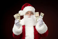 Santa Claus with dollars Stock Image