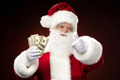 Santa Claus with dollars Royalty Free Stock Photography