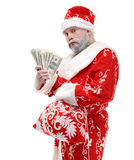 Santa Claus with dollars on a white background. Santa Claus with a bundle of money Royalty Free Stock Images
