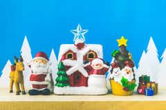 Santa Claus dolls and Christmas decorations box on wooden Stock Photo
