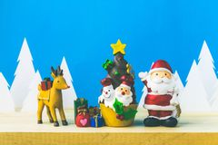 Santa Claus dolls and Christmas decorations box on wooden Stock Photography