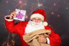 Santa Claus drôle ont un amusement Image stock