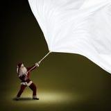 Santa Claus drar banret Arkivbild
