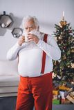 Santa claus drinking coffee Stock Images