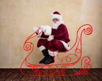 Santa Claus drive in imaginary sleigh Royalty Free Stock Images