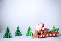 Santa claus driving train with pulling christmas trees and gift Stock Images
