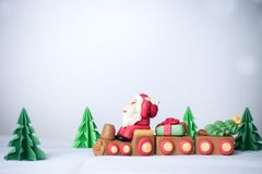 Santa claus driving train with pulling christmas trees and gift Royalty Free Stock Image
