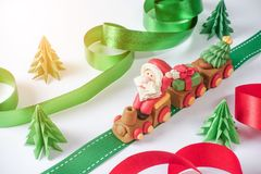 Santa claus driving train on ribbon with pulling christmas trees Royalty Free Stock Photography
