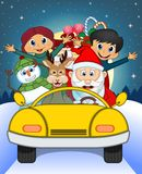 Santa Claus Driving a Yellow Car Along With Reindeer, Snowman, Children, and Full Moon  Stock Photography