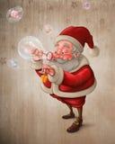 Santa Claus e o sabão das bolhas Foto de Stock