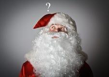 Santa Claus e punto interrogativo Immagine Stock Libera da Diritti