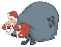 Santa Claus e un sacco in pieno dei regali Immagine Stock