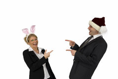 Santa Claus with Easter Bunny. Woman as Easter Bunny and men as Santa Claus Stock Photo