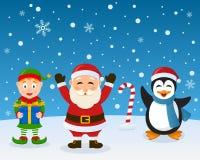 Santa Claus Elf Penguin på snön Royaltyfria Foton