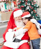 Santa Claus Embracing Girl Stock Images
