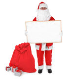 Santa claus and empty board Stock Photography