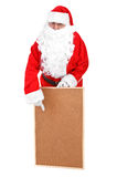 Santa claus and empty bulletin board Stock Images
