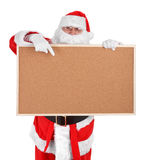Santa claus and empty bulletin board Royalty Free Stock Photo
