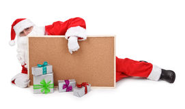 Santa claus and empty bulletin board Royalty Free Stock Photography