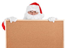 Santa claus and empty bulletin board - close-up Royalty Free Stock Photo
