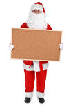 Santa claus and empty bulletin board Royalty Free Stock Photos