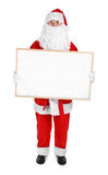 Santa claus and empty bulletin board Royalty Free Stock Images