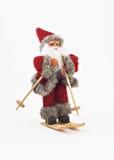 Santa Claus en árbol de los esquís un juguete aislado Fotos de archivo libres de regalías