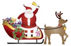 Santa Claus en el trineo del reno que entrega el ejemplo de los presentes Imagen de archivo