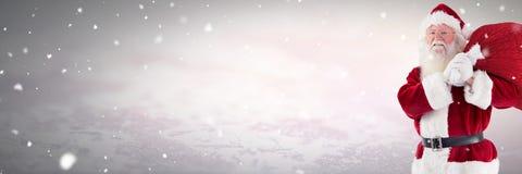 Santa Claus en hiver avec le sac Photographie stock