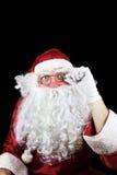 Santa Claus en la noche de la Navidad aislada en fondo negro Fotos de archivo