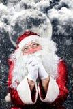 Santa Claus en la rogación de la noche de la Navidad Imagenes de archivo