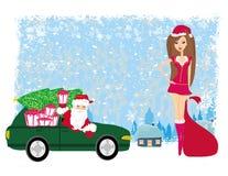 Santa Claus en mooie vrouw Stock Foto's