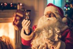 Santa Claus en su residencia Fotos de archivo