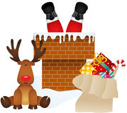 Santa Claus entering through the chimney with reindeer Royalty Free Stock Image