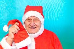 Santa Claus erbjudande julhatt royaltyfri fotografi