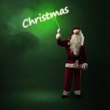 Santa Claus está guardando uma palavra de brilho do Natal Fotografia de Stock Royalty Free