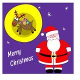 Santa Claus et cerfs communs avec des cadeaux Carte de Noël Image stock