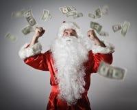 Santa Claus et dollars Santa Claus avec ses mains  Photographie stock libre de droits