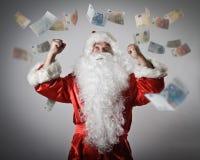 Santa Claus et euro Santa Claus avec ses mains  Images libres de droits
