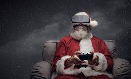 Santa Claus experiencing virtual reality Royalty Free Stock Images