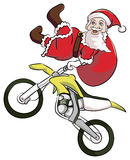 Santa claus extreme motocross. Santa claus act like a freestyler motocross jump high Stock Image