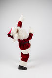 Santa Claus in eyeglasses and red costume points out with hands and looking into camera. Stock Photography