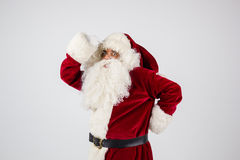 Santa Claus in eyeglasses and red costume put hands on head Stock Photos