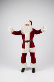 Santa Claus in eyeglasses and red costume  throwing up hands Stock Photo