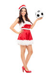 Santa Claus féminine tenant un football Photo libre de droits